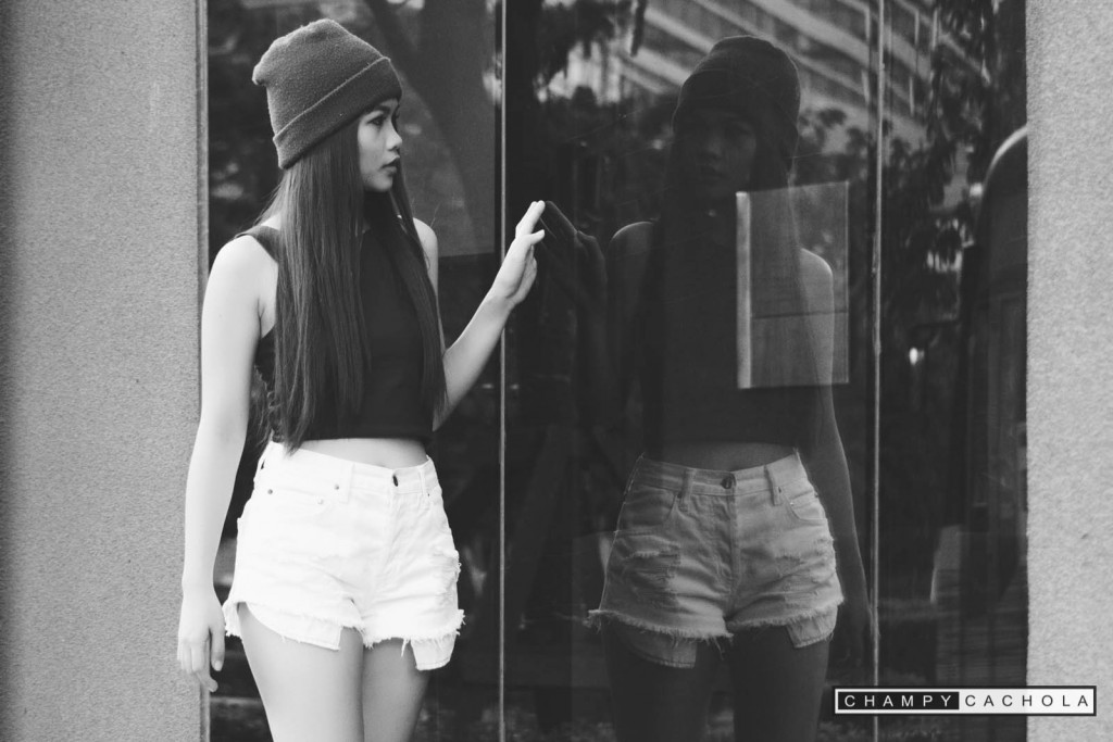 black and white candid shot of ssang tribusias with mirror reflection. photo taken at bonifacio global city in taguig.