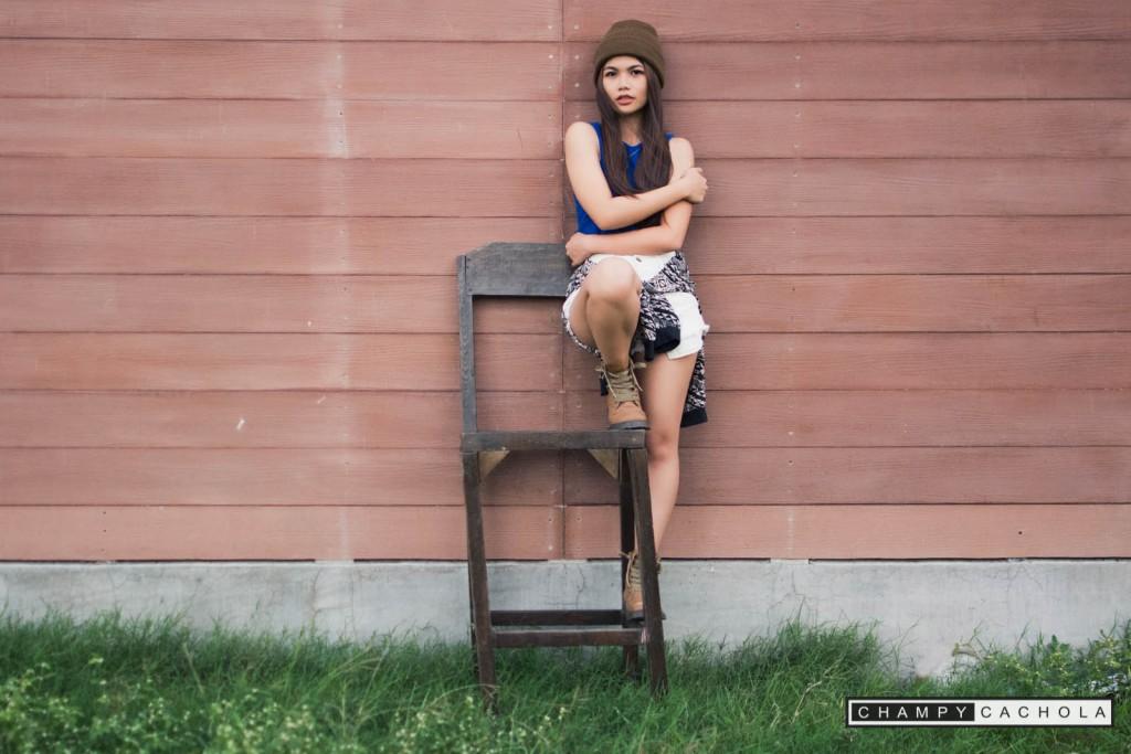 portrait of jessa tribusias on a broken chair.