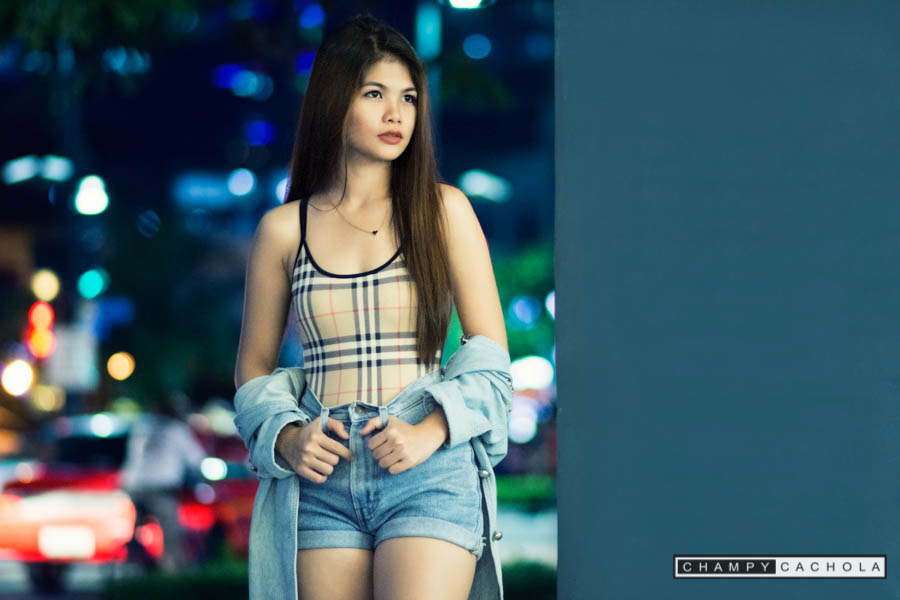 portrait of ssang tribusias with street lights background. photo taken at bgc, taguig.